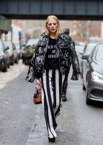pants nyfw 2017 fashion week 2017 fashion week streetstyle stripes striped pants wide-leg pants bag bucket bag sweater sweatshirt black sweater jacket printed jacket floral floral jacket