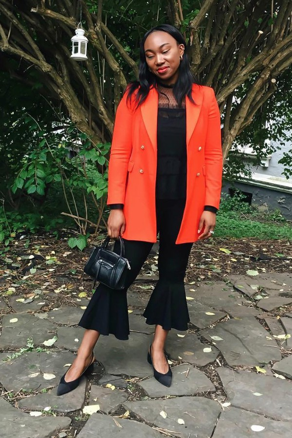 top black top blazer orange blazer pants black pants shoes bag