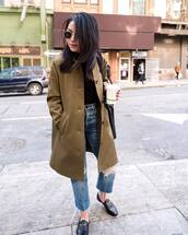 coat,long coat,olive green,jeans,cropped jeans,ripped jeans,loafers,black blouse,sunglasses