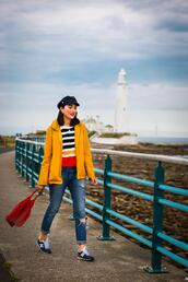 preppy fashionist,blogger,hat,coat,sweater,jeans,bag,red bag,sneakers,yellow jacket