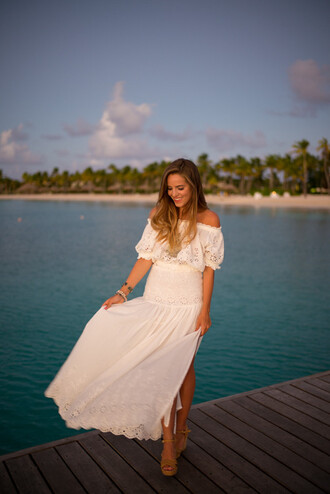 gal meets glam blogger boho chic summer outfits off the shoulder white top maxi skirt white skirt wedge sandals