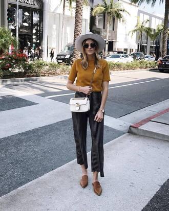 pants hat tumblr wide-leg pants black pants stripes striped pants t-shirt yellow yellow top shoes mules flats bag white bag