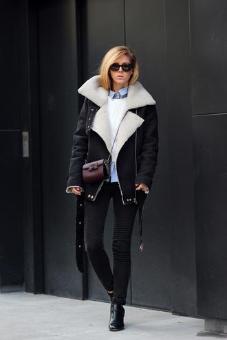 sirma markova blogger shearling jacket black jeans skinny jeans mini bag