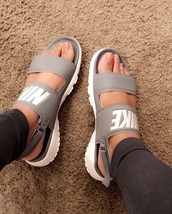 shoes,nike,sandals,gray nike sandals,nike sandals,nike shoes,grey nike sanders withh bands on top,nike slippers,cute,slippers,cute sandals,slide shoes,grey,nike slides,double strap slides