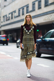dress,fashion week street style,fashion week 2016,fashion week,london fashion week 2016,asymmetrical,asymmetrical dress,floral dress,midi dress,top,burgundy top,burgundy,long sleeves,boots,white boots,fall outfits,streetstyle,flat boots