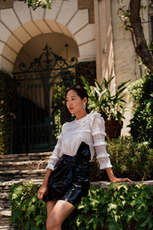 skirt,blogger,blogger style,mini skirt,ruffled top,blouse,clutch,louis vuitton,vinyl skirt,ruffle