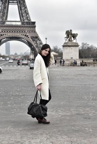 views by laura blogger white coat black bag