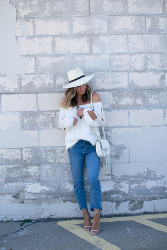 cella jane blogger blouse jeans shoes bag sunglasses hat cropped jeans blue jeans cropped blue jeans white bag shoulder bag tassel bag off the shoulder off the shoulder top white top long sleeves white hat sandals sandal heels high heel sandals nude sandals spring outfits white off shoulder top puffed sleeves
