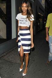 t-shirt,slit pencil skirt,slogan t-shirts,white crop tops,white and blue skirt,striped skirt,pencil skirt,front wrap shirt,stilettos,jourdan dunn