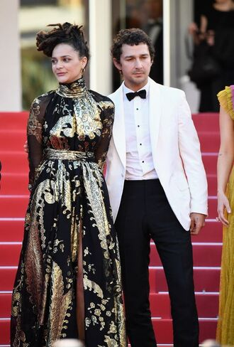dress shia labeouf sasha lane actress celebrity style celebrity red carpet red carpet dress gold dress maxi dress long dress long sleeve dress hairstyles menswear mens suit
