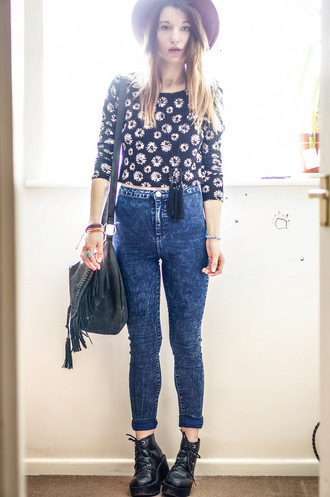laughing in the purple rain blogger bag hat skinny jeans acid wash jeans fringed bag daisy