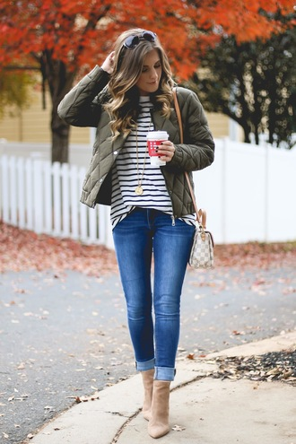 thedaintydarling blogger jacket top jeans jewels shoes sunglasses fall outfits shoulder bag striped top ankle boots louis vuitton bag green jacket