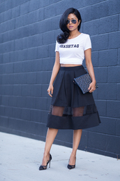 walk in wonderland,t-shirt,skirt,shoes,bag,black midi skirt,black aviators,black net pumps,black clutch,zipper clutch,midi skirt,organza skirt,white t-shirt,black pumps,black stilettos,slogan t-shirt,white crop tops