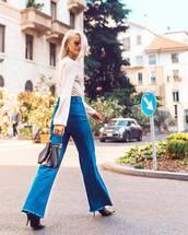 jeans,flare jeans,high waisted jeans,high heel pumps,pumps,handbag,blouse,sunglasses,earrings