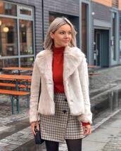 skirt,plaid skirt,tights,black bag,white coat,faux fur coat,red top,turtleneck