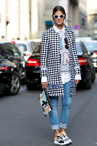 top graphic sweatshirt sweatshirt grey sweater jeans denim blue jeans cuffed jeans streetstyle coat checkered shirt white shirt sneakers grey sneakers pouch printed pouch sunglasses white sunglasses fall outfits tumblr printed coat