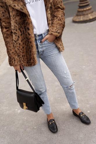 fadela mecheri blogger t-shirt jeans shoes bag faux fur coat black bag shoulder bag loafers gucci shoes