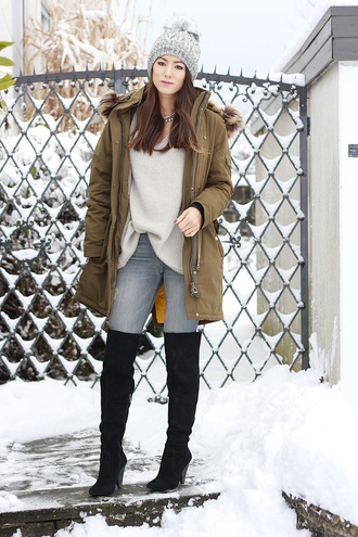 seekingsunshine blogger jewels coat sweater jeans shoes hat green coat beanie winter outfits boots over the knee boots