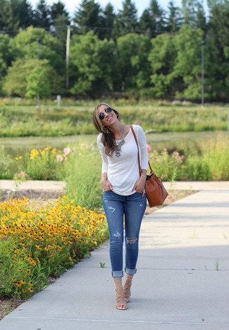 lilly style blogger top jeans shoes bag jewels sunglasses dress t-shirt white top long sleeves statement necklace ripped jeans brown bag shoulder bag lace up lace up heels