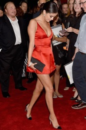 selena gomez orange dress short,red dress,red satin,hair,selena gomez hair,satin dress,heels,high heels,bun,selena gomez bag,clutch,black clutch,dress,bra dress,red,silk