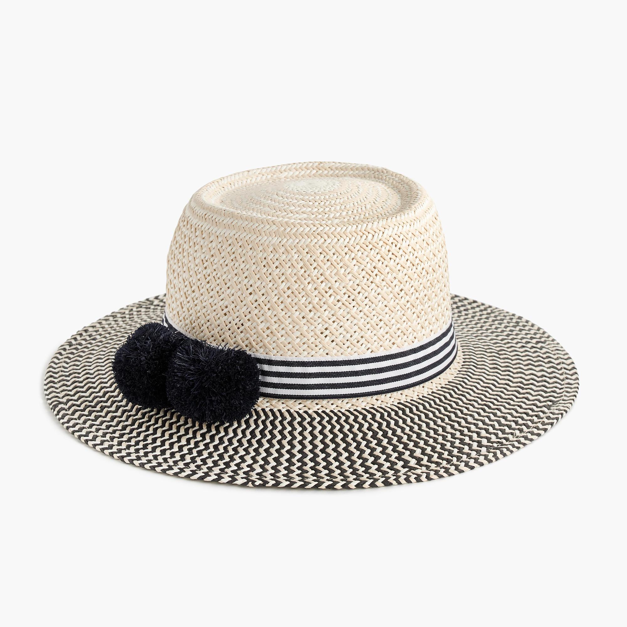 ff10c211 Straw hat with pom-poms