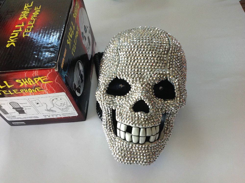 1 pcjewelled telephone w/led eyes flashing/crystal stone covered all skull head