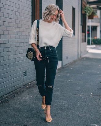 sweater black bag white sweater blue jeans ripped jeans denim jeans sandal heels sandals high heel sandals bag