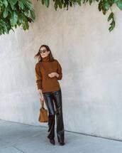 bag,handbag,flare pants,leather pants,turtleneck,turtleneck sweater,sunglasses,earrings