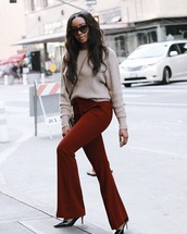 pants,red pants,flare pants,sweater,nude sweater,sunglasses,shoes,heels