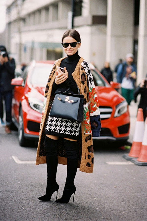 vanessa jackman blogger cardigan printed cardigan miroslava duma top black top turtleneck houndstooth mini skirt bag black bag celine bag over the knee boots thigh high boots boots sunglasses black turtleneck top