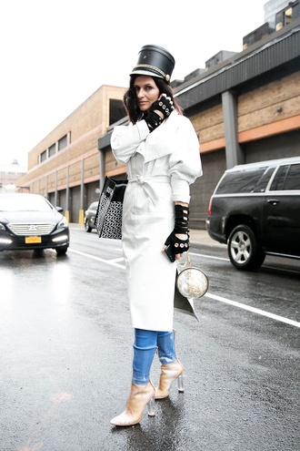 coat nyfw 2017 fashion week 2017 fashion week streetstyle white coat hat gloves bag printed bag denim jeans blue jeans boots clear boots high heels boots transparent boots