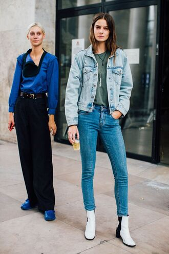 shoes fashion week street style fashion week 2016 fashion week paris fashion week 2016 white shoes denim jeans blue jeans jacket blue jacket top green top necklace ankle boots mid heel boots streetstyle tumblr