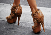 shoes,high heels,heels,booties,high heeled booties,high heel booties,tan,nude,cognac,brown,wedges,brown high heels,beige shoes,leather,faux leather,platform heels,lace up,cut out heels,wooden,design,cute,chic,zip up heels,high heel with zippers