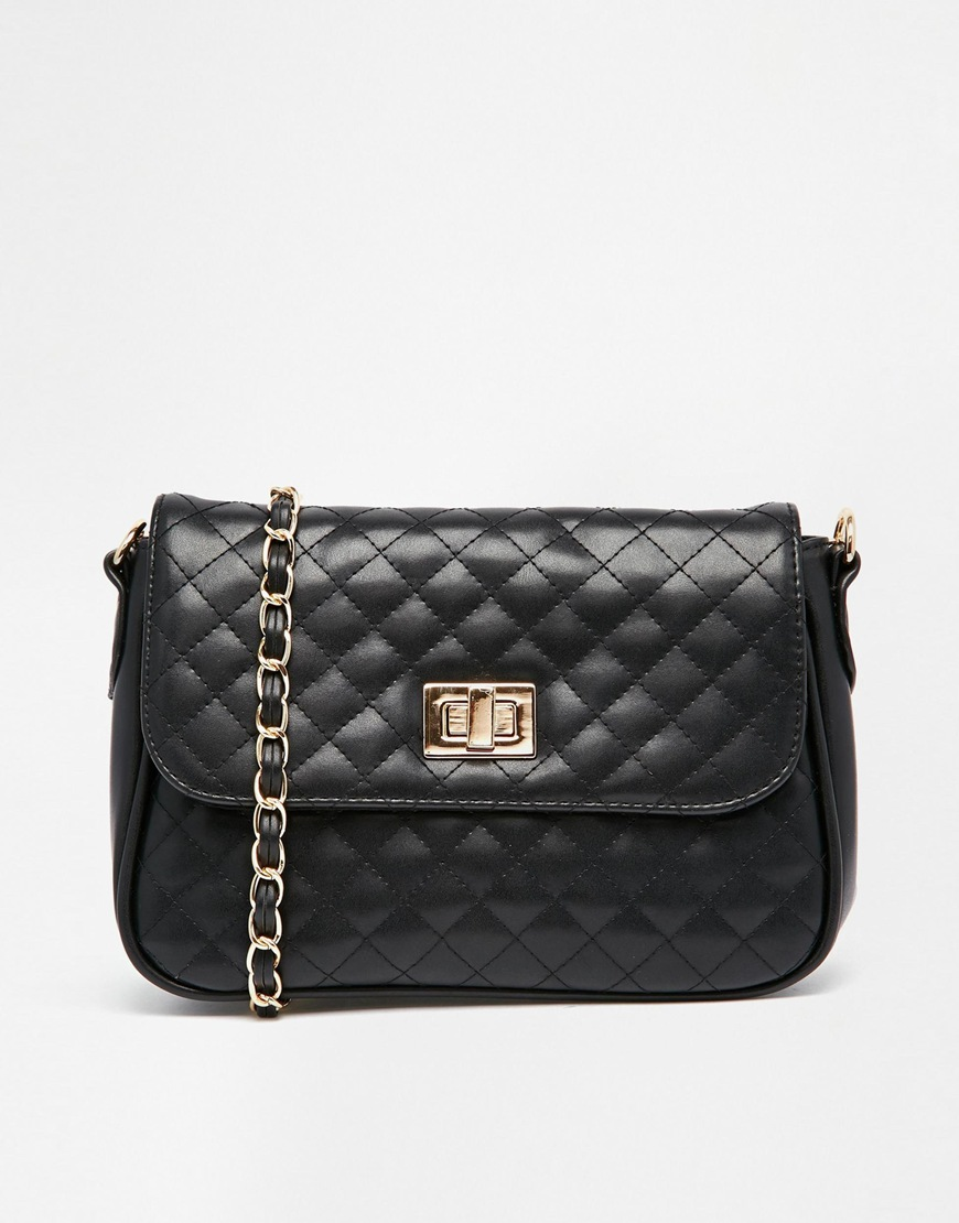 1857bb6bc66 ASOS Quilted Lock Cross Body Bag at asos.com