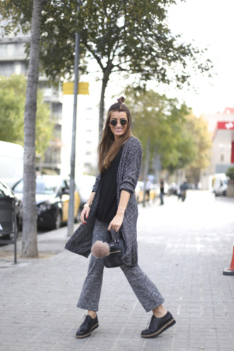 b a r t a b a c blogger fur keychain grey cardigan bag accessories black bag cardigan black top top sunglasses round sunglasses flare pants grey pants black shoes flats fall outfits