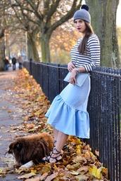 thank fifi,blogger,jewels,blue skirt,pom pom beanie,ruffle,striped shirt,clutch