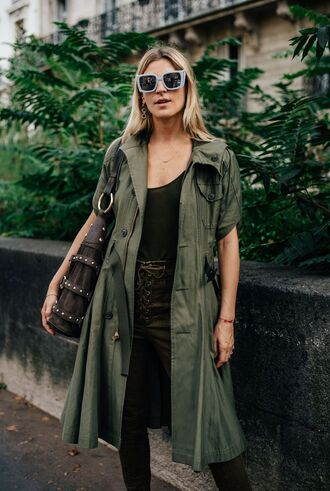 coat green top fashion week street style fashion week 2016 fashion week paris fashion week 2016 green coat green pants pants lace up pants top bag brown bag sunglasses blue sunglasses streetstyle