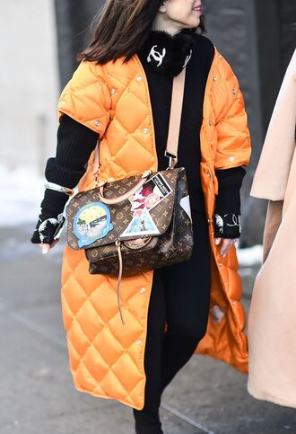 coat nyfw 2017 fashion week 2017 fashion week streetstyle orange orange coat quilted bag louis vuitton louis vuitton bag leggings black leggings sweater black sweater earmuffs