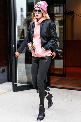 jacket bomber jacket black bomber jacket hoodie beanie black pants leather pants boots black boots pointed boots gigi hadid celebrity pink sweater black jeans