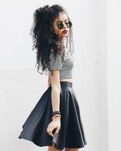 black,grunge wishlist,curly hair,leather skirt,skater skirt,crop tops,striped top,round sunglasses