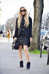 5 inch and up,blogger,coat,sunglasses,fringe skirt,fringes,leather skirt,black sunglasses,black bag,sweater,skirt,shoes,bag