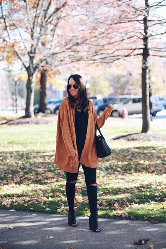 fashionably kay blogger cardigan tank top shoes bag handbag peep toe boots ankle boots black jeans camel cardigan black bag aviator sunglasses black top black ripped jeans ripped jeans peep toe heels