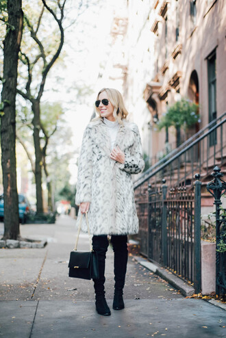 katie's bliss - a personal style blog based in nyc blogger coat shoes bag jeans fur coat thigh high boots black bag black boots printed fur coat long fur coat