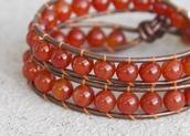jewels,beaded leather wrap,double wrap bracelet,semi-precious beaded bracelet,wrap around bracelet,carnelian bracelet,beads and leather,natural leather,eco friendly,eco friendly leather bracelet,leather wrap bracelet