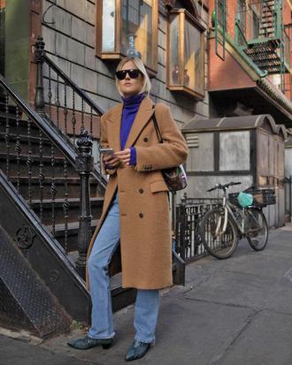 coat tumblr camel camel coat top turtleneck blue sweater turtleneck sweater denim jeans light blue jeans boots sunglasses