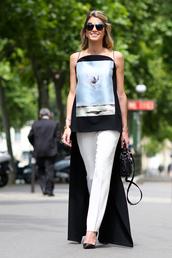 top,asymmetrical top,asymmetrical,black top,graphic top,spaghetti strap,sunglasses,pants,white pants,pumps,pointed toe pumps,high heel pumps,bag,black bag,streetstyle