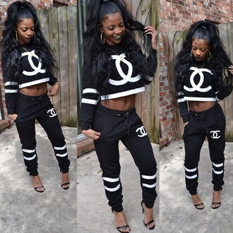sweater pants shirt crop outfit tumblr outfit baddies bad bitches link up black girls killin it two-piece joggers black and white chanel t-shirt coco sweater chanel purse chanel sweatshirt urban hat cropped sweater tracksuit jumpsuit top crop tops cc chanel hoody white cc chanel hoodie