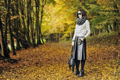 shiny sil,blogger,tights,scarf,sunglasses,top,jewels,leather skirt,black boots,jumper,fringed bag