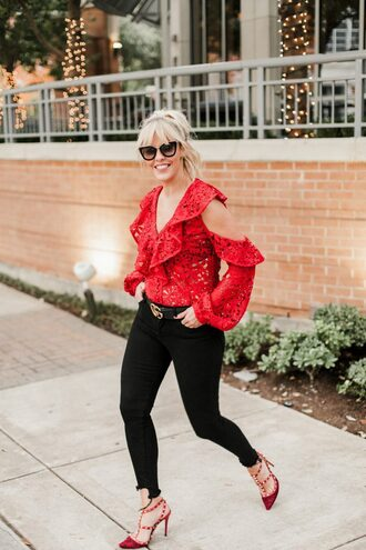 the courtney kerr blogger blouse jeans shoes belt sunglasses jewels red top pumps red heels gucci belt black jeans