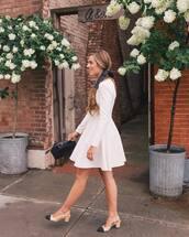 dress,long sleeve dress,white dress,handbag,black bag,mid heel pumps